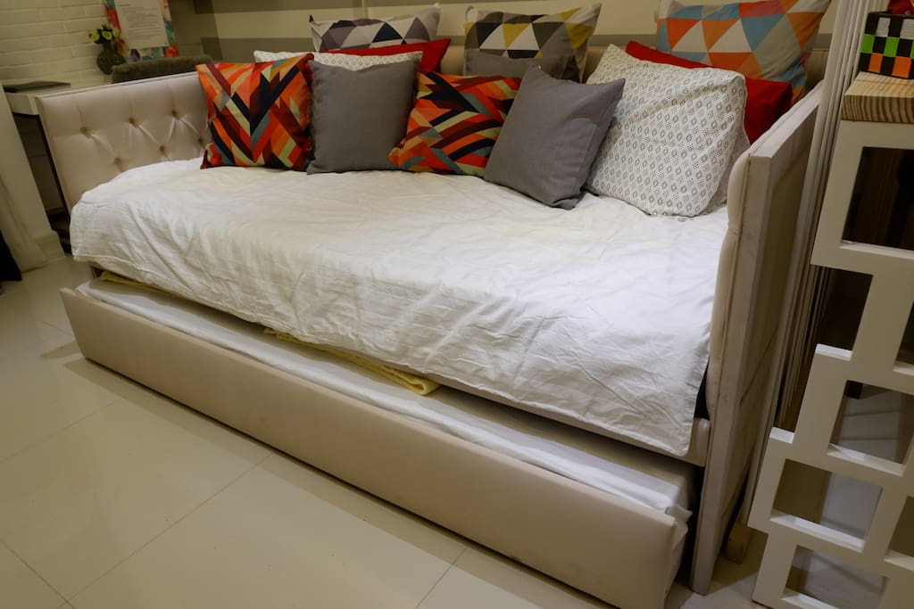 Bespoke queen-sized sofa bed with a pull-out bed that can accommodate 3 persons