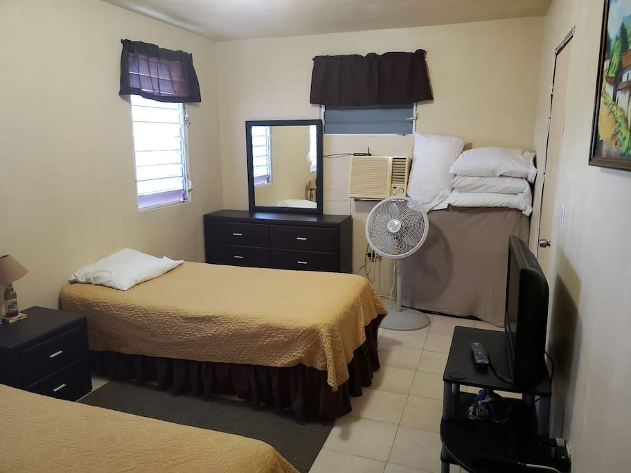 Bedroom with TV, AC, Wifi, Rollaway bed