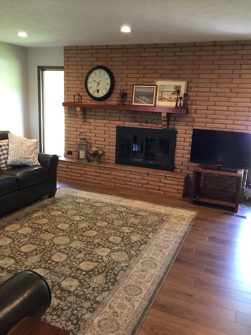 Large family room provides comfort for many. TV has 25+ local channels with Chrome Cast capability and WIFI.