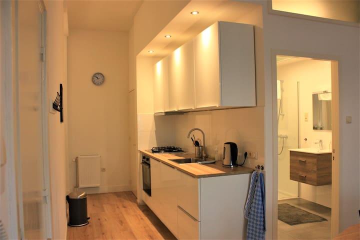 Gloednieuw appartement met 2 slaapkamers en tuin