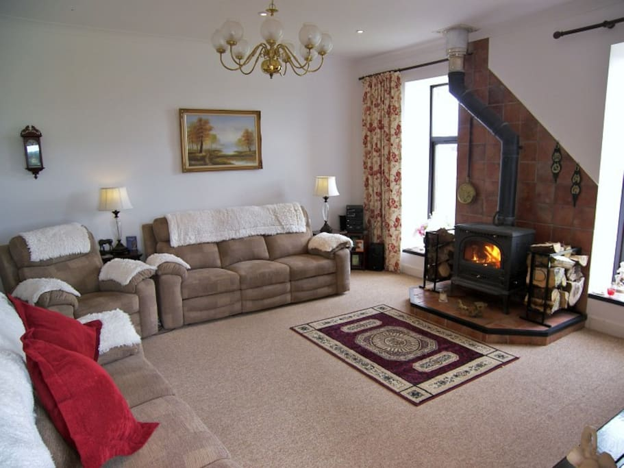 Large lounge with wood burning stove for cosy winter evenings