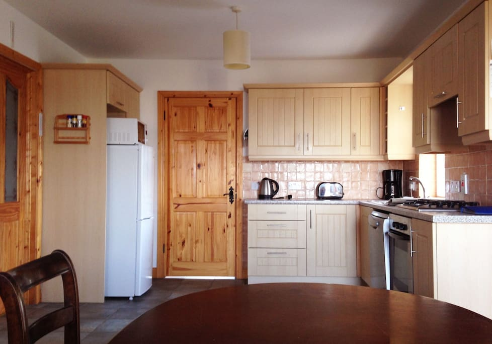 Kitchen with all new appliances - refrigerator, microwave, dishwasher, washing machine