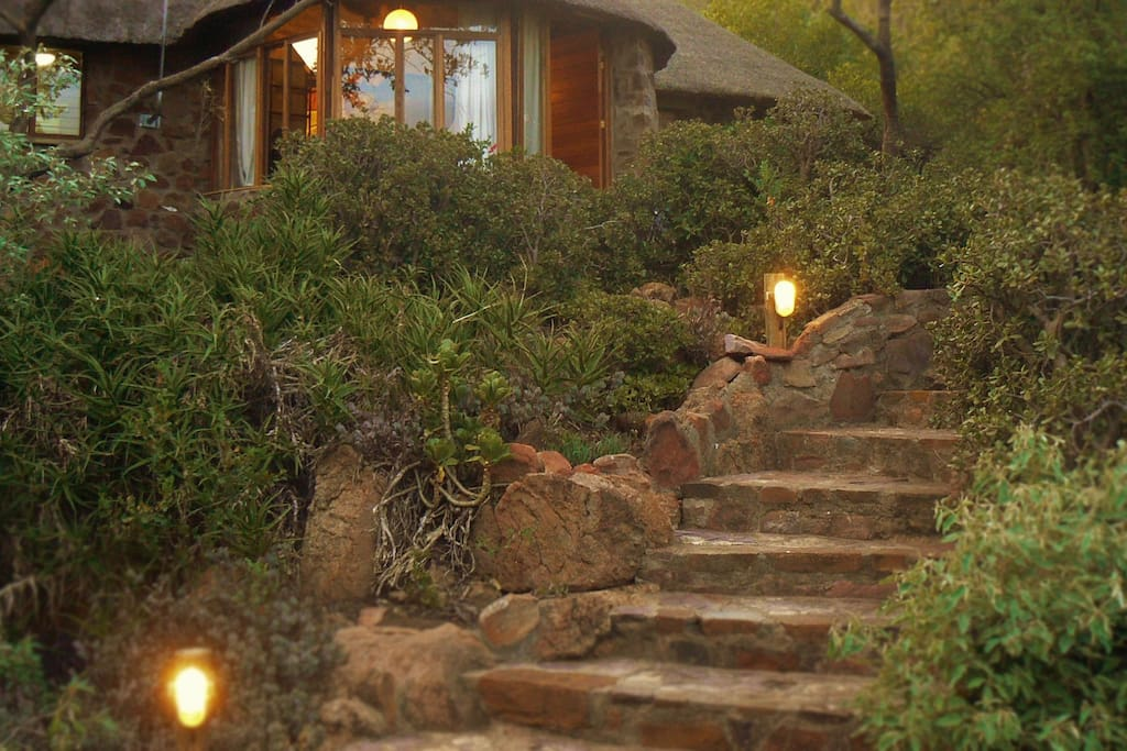 Nare house has a private rock staircase entrance, That leads from the covered parking