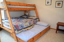 Upper bedroom with bunk bed with trundle bed.  Top bunk - Twin bed, Bottom bunk - Double bed with twin size trundle underneath
