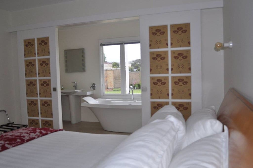 Bedroom opens up to the luxury ensuite with a view