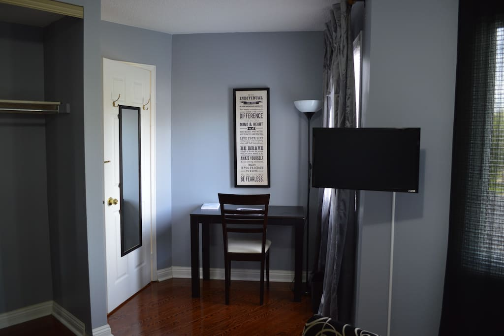 Work station with cushion chair and desk with drawer. Separate lighting provided for work area. The smart tv swivels out and can be viewed comfortably from the bed.