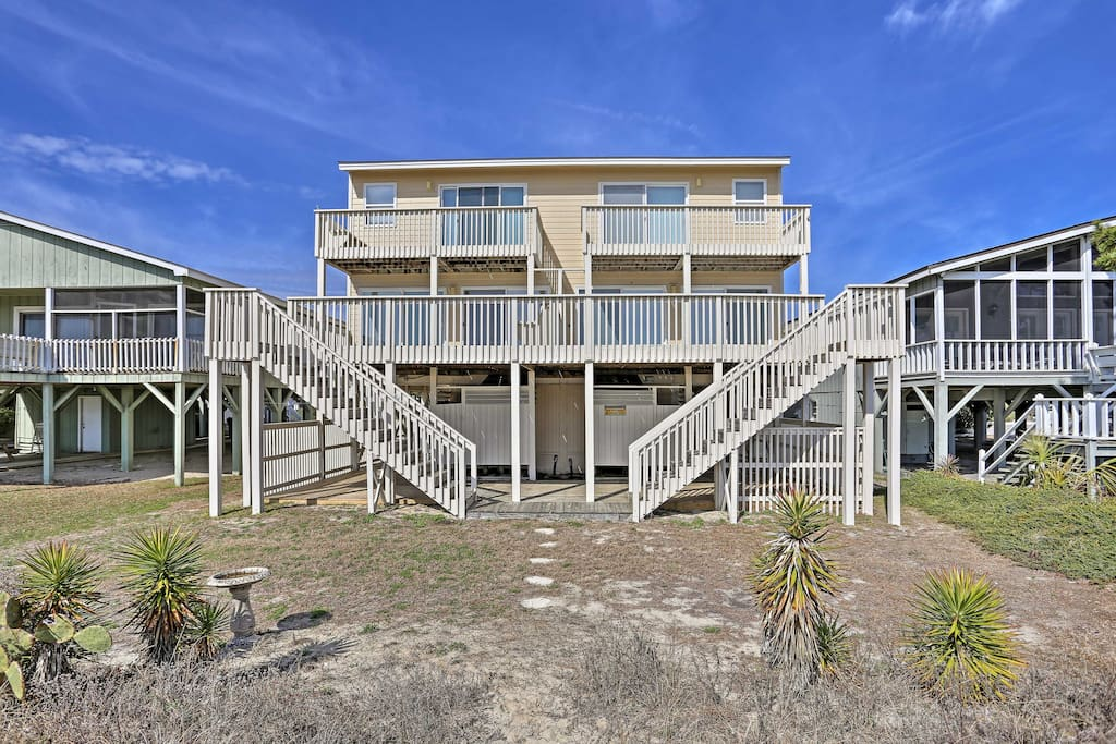 This breezy abode is located within steps of the stunning beach!