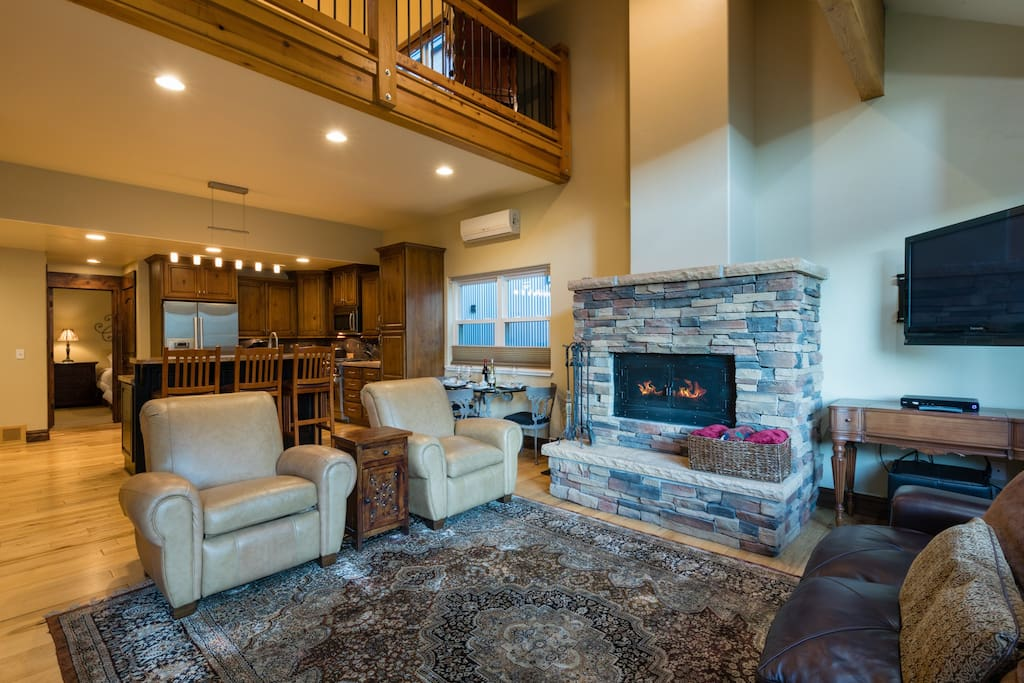 Cozy Family room with wood burning fireplace and LED TV