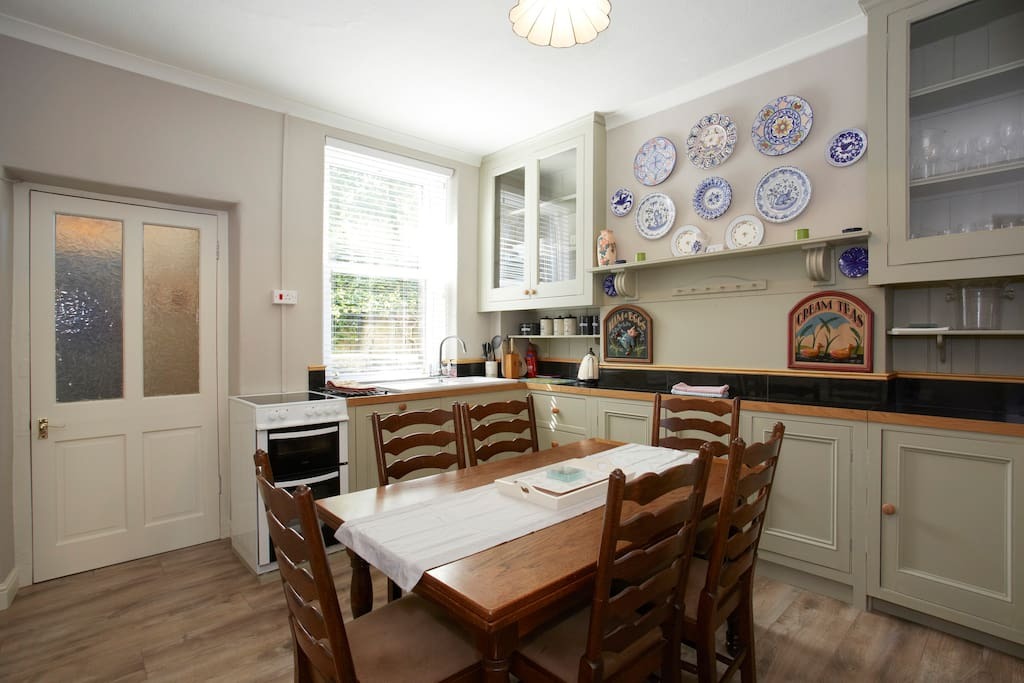 Bright sunny kitchen with built in dishwasher and laundry annex