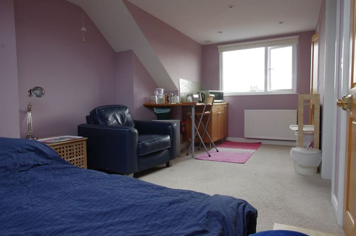 Light, bright, private loft room with ensuite.