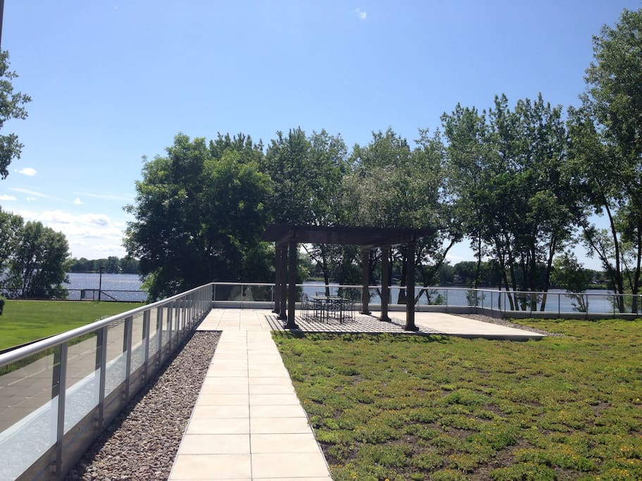 Private water view and access to pergola and dining sets: one dinning table with eight chairs.