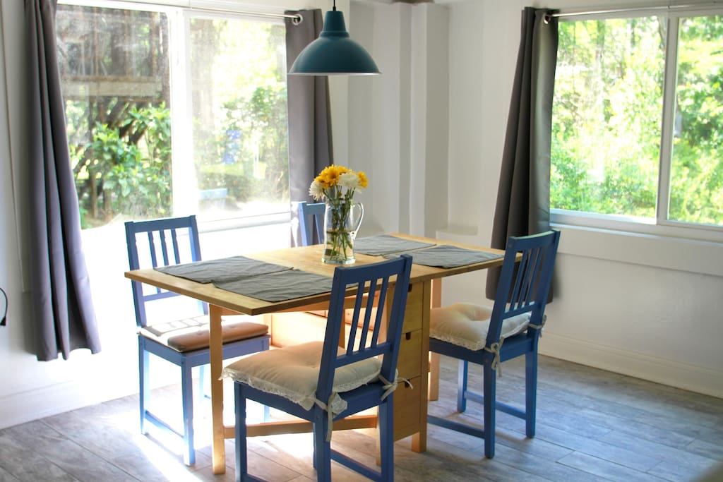 Fresh dining area with huge windows and plenty of natural light.