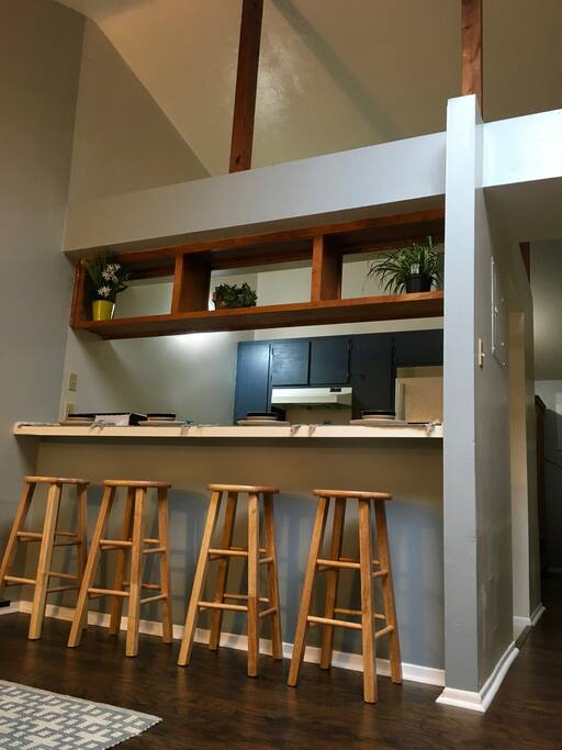 There are high ceilings, raw wood beams, and a skylight that all open up the space. The one-bedroom apartment has all new wood flooring and paint.