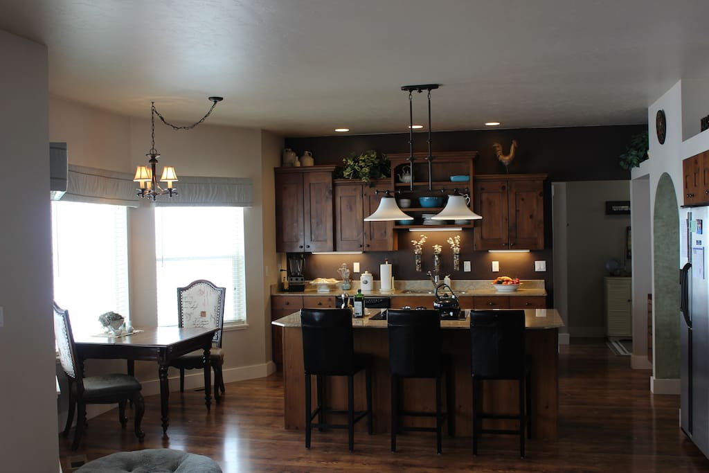Enjoy cooking or just gathering in the lovely kitchen area. Back yard and mountain views