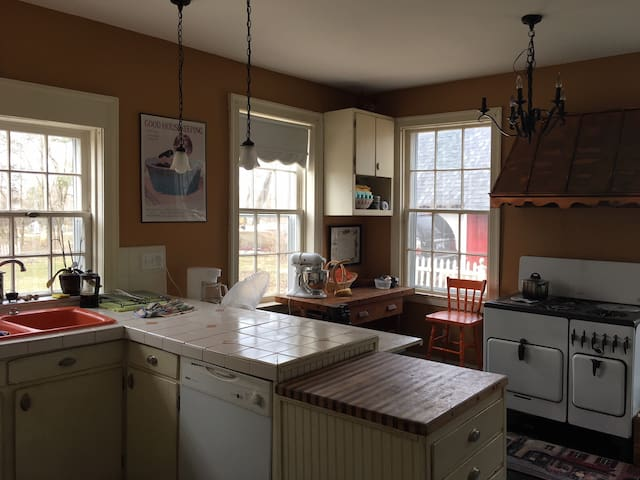 Shared kitchen with dishwasher and pots, pans, dishes, etc. provided.