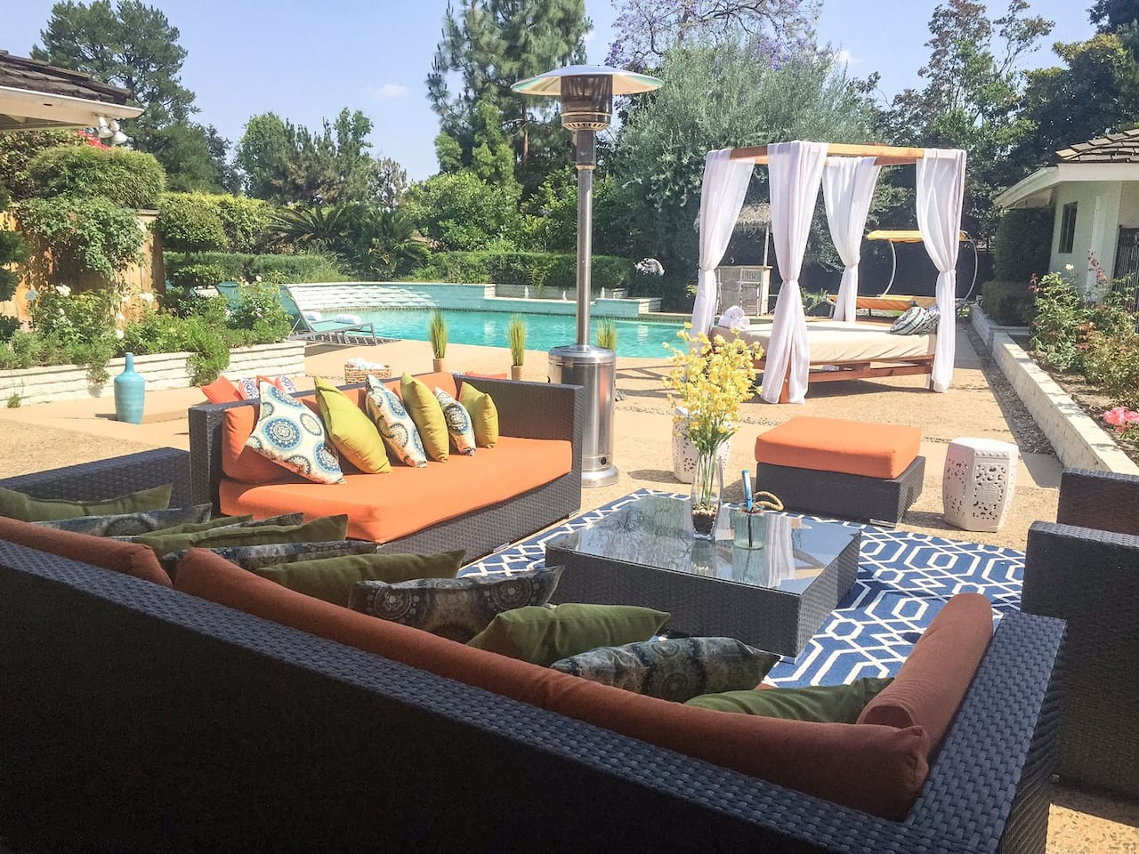Resort Style Back Yard - Consist of Patio Furniture, 2 Day beds and 4 Chaise Loungers.