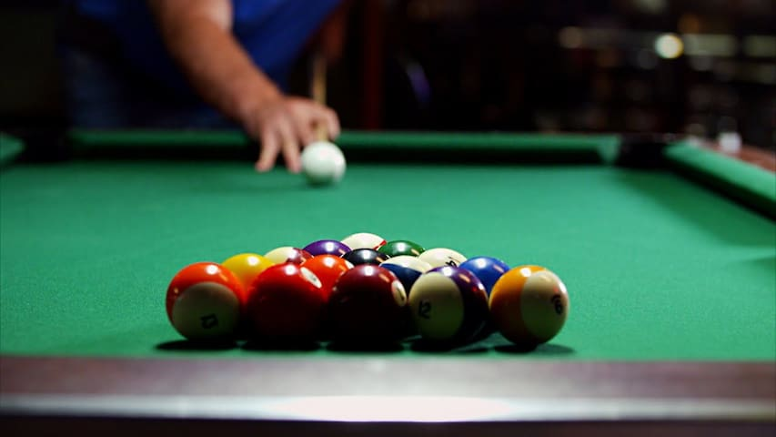 """Our """"Pool Barn"""" recreation space includes darts, ping pong, pool table, air hockey, foosball, golf putting, and bag toss too!"""