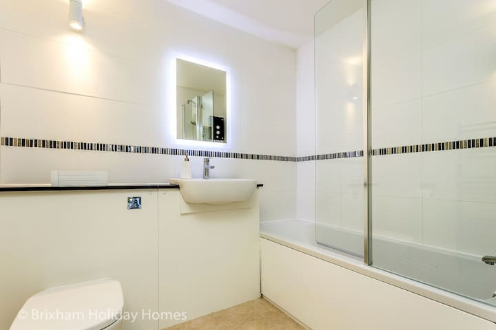 En-suite bathroom with bath & shower over