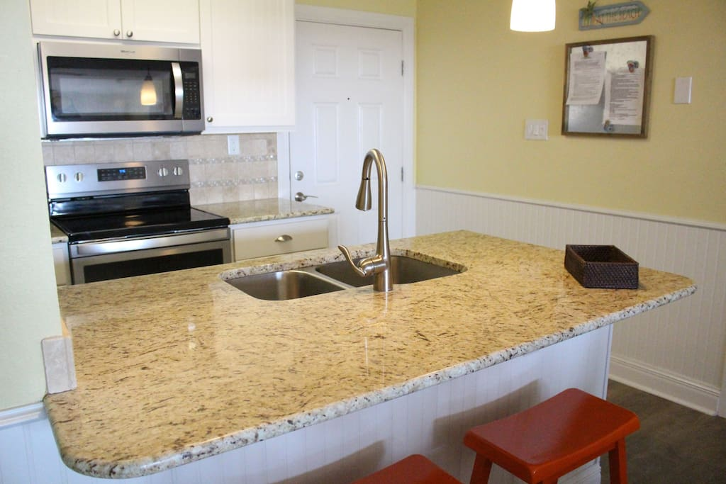 Open kitchen with granite counter tops