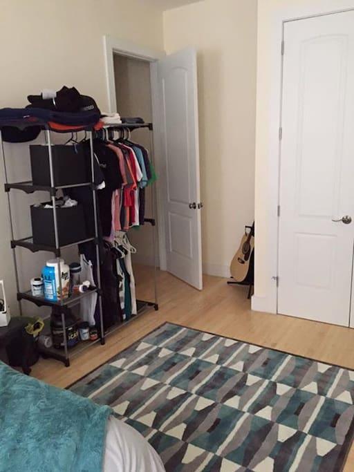 Open Floor with Clothing Rack