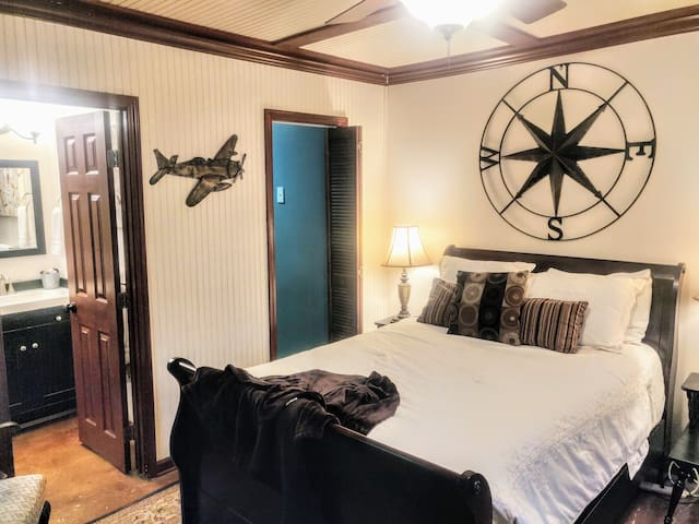 Comfy, full, sleigh bed.  Aviation themed room.