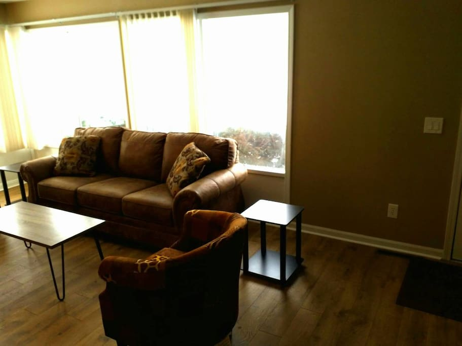 Living Room Has L Shape Windows for Stunning Lawn View