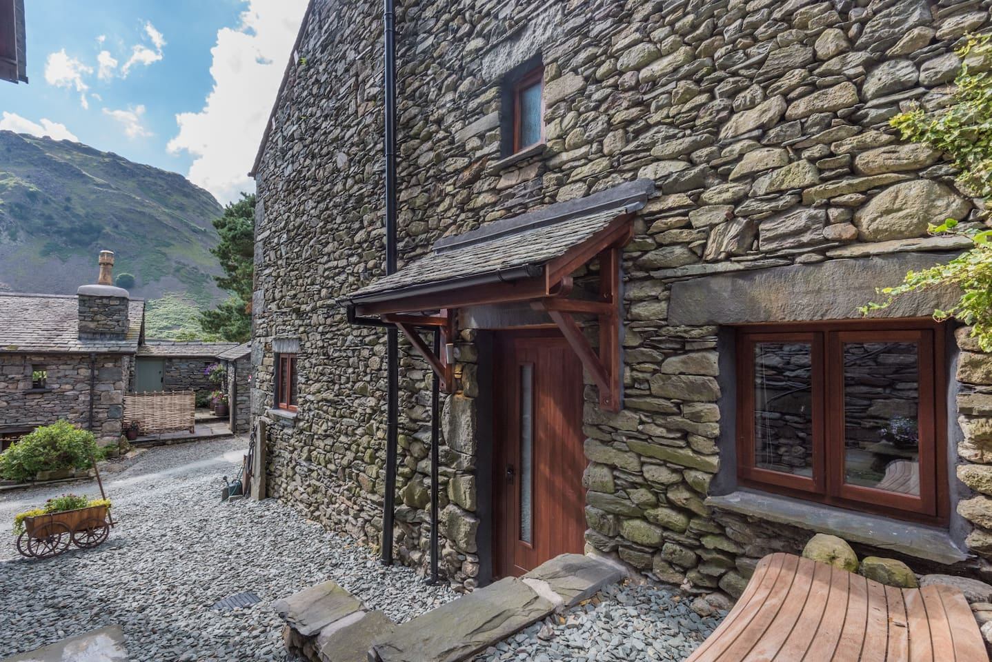 The outside space and entrance, with Helm Crag (Lion & the Lamb) in the distance