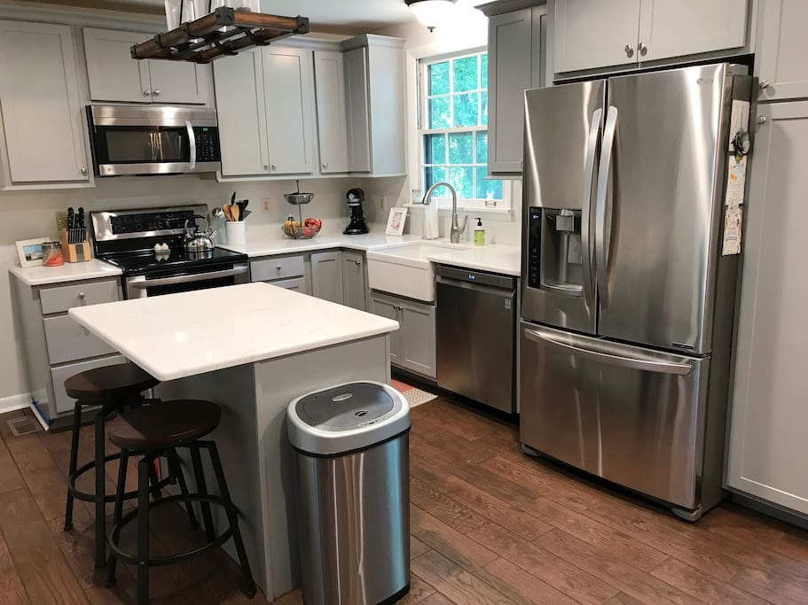 Newly renovated kitchen with new stainless steal appliances. Island with 2 bar stools.