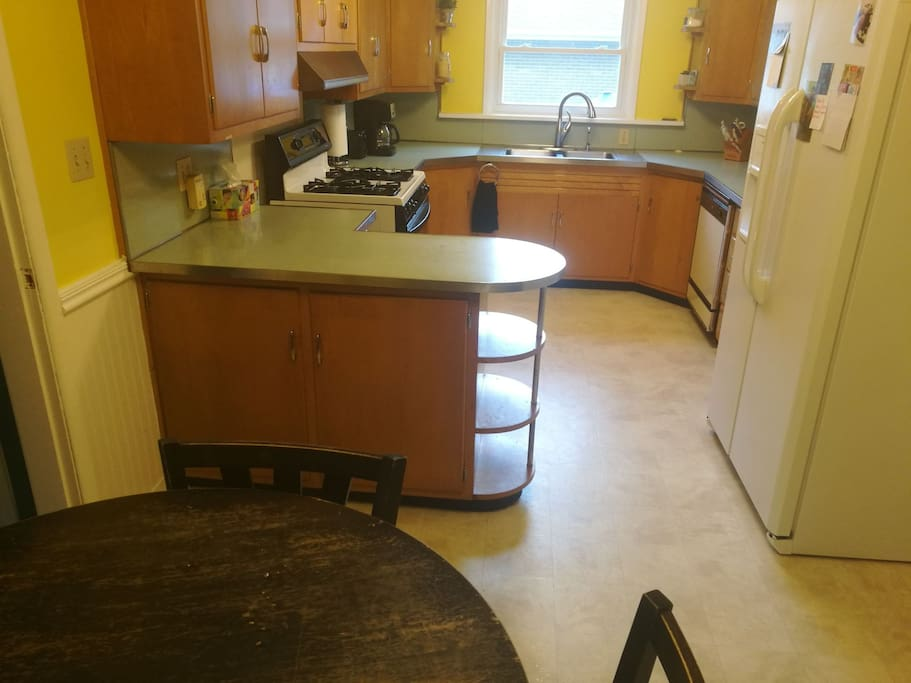 Full kitchen with all appliances and a small four person table.