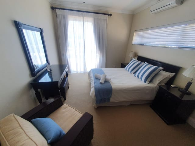 Room 4 - Sleeps 2 on a queen size bed with en-suite and sliding doors leading out onto the wrap around deck