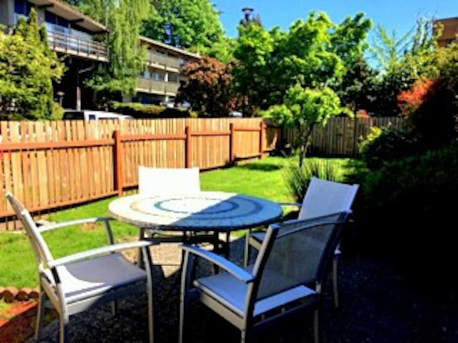 Large fully private fenced yard with outdoor dining and a place to run around and play.  And just across the street is a large park with play equipment.