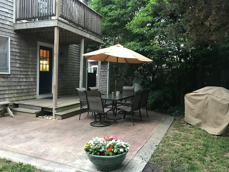 Back yard patio for grilling and summer dinners with outdoor shower