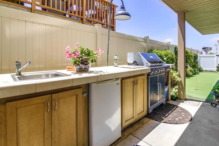 A refrigerator full of beer, a BBQ grill, and plenty of counter space next to the sink!