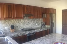 Gas stove, microwave, Fridge with filtered purified water and ice machine.