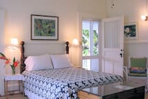 Queen bed in Shipman House Guest Cottage's Makai Room. The headboard was the footboard of the bed Jack London slept in.