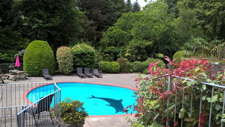 Waterfall cottage with shared pools, tennis court