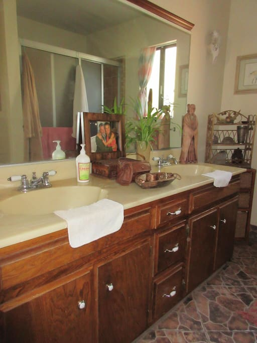 Private bathroom has large shower & two sinks.