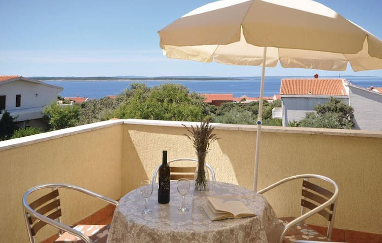 Two bedroom apartment with terrace and sea view Mandre, Pag (A-12409-b)