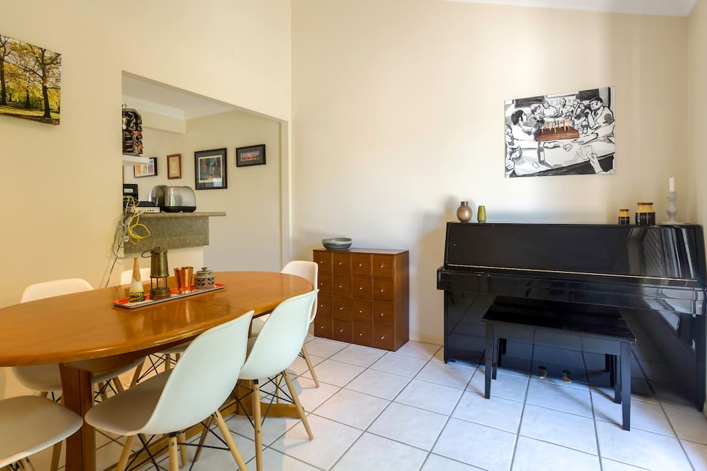 Dining room with piano for your enjoyment.