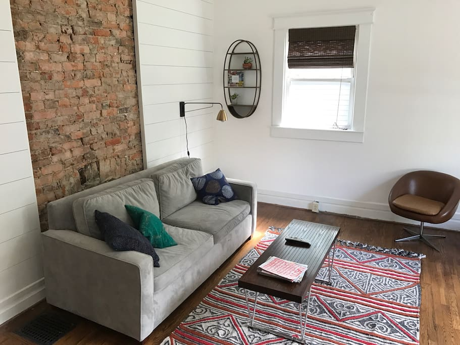 """Cozy living room that doubles as a 5th bedroom with pull out queen bed. Includes 50"""" LED TV."""