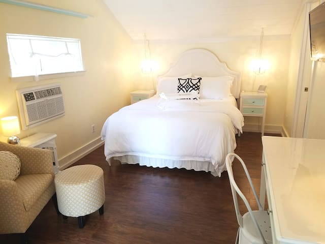 The suite is about 250 square feet with beautiful floors, tall ceilings and lots of natural light.