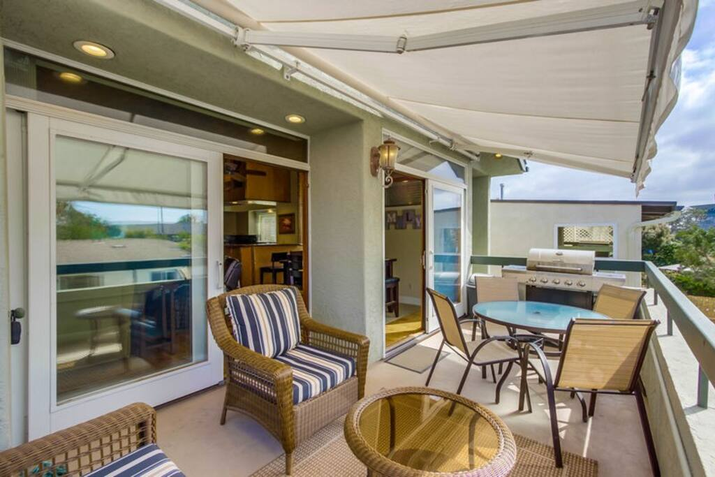 Outdoor patio with retractable awning and bbq