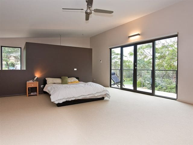 Main mezzanine bedroom with ensuite and walk in robe.