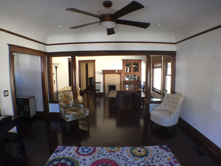 Fully restored original built-in cabinet and  original wood work makes this open living room and formal dining room a great space to relax, work, or to be creative.