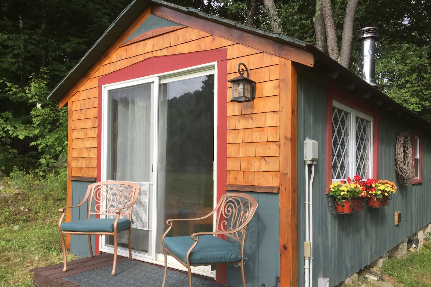 Get up close, peaceful and personal with nature in the comfort of your own private and charming cabin looking out onto green Vermont pasture.