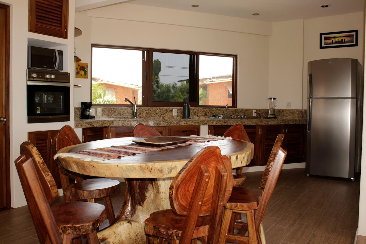 large kitchen with dinning table