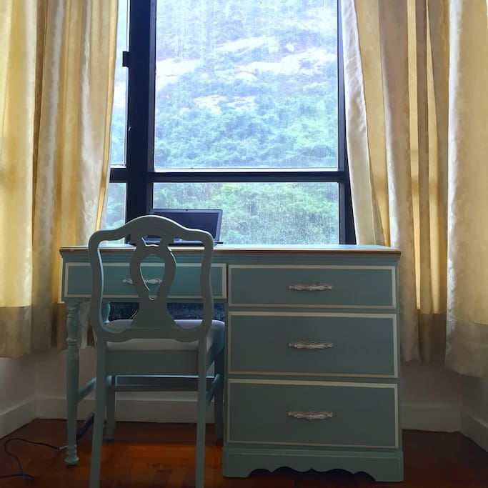 Desk in bedroom overlooking Victoria Peak