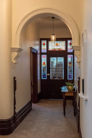 Stain glass features throughout, to the left is the door for the ground floor QS bedroom. King and Double bedrooms are upstairs.