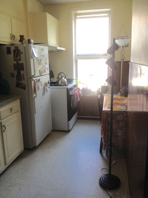 our cute little kitchen. stocked with spices, cookware & basic condiments.