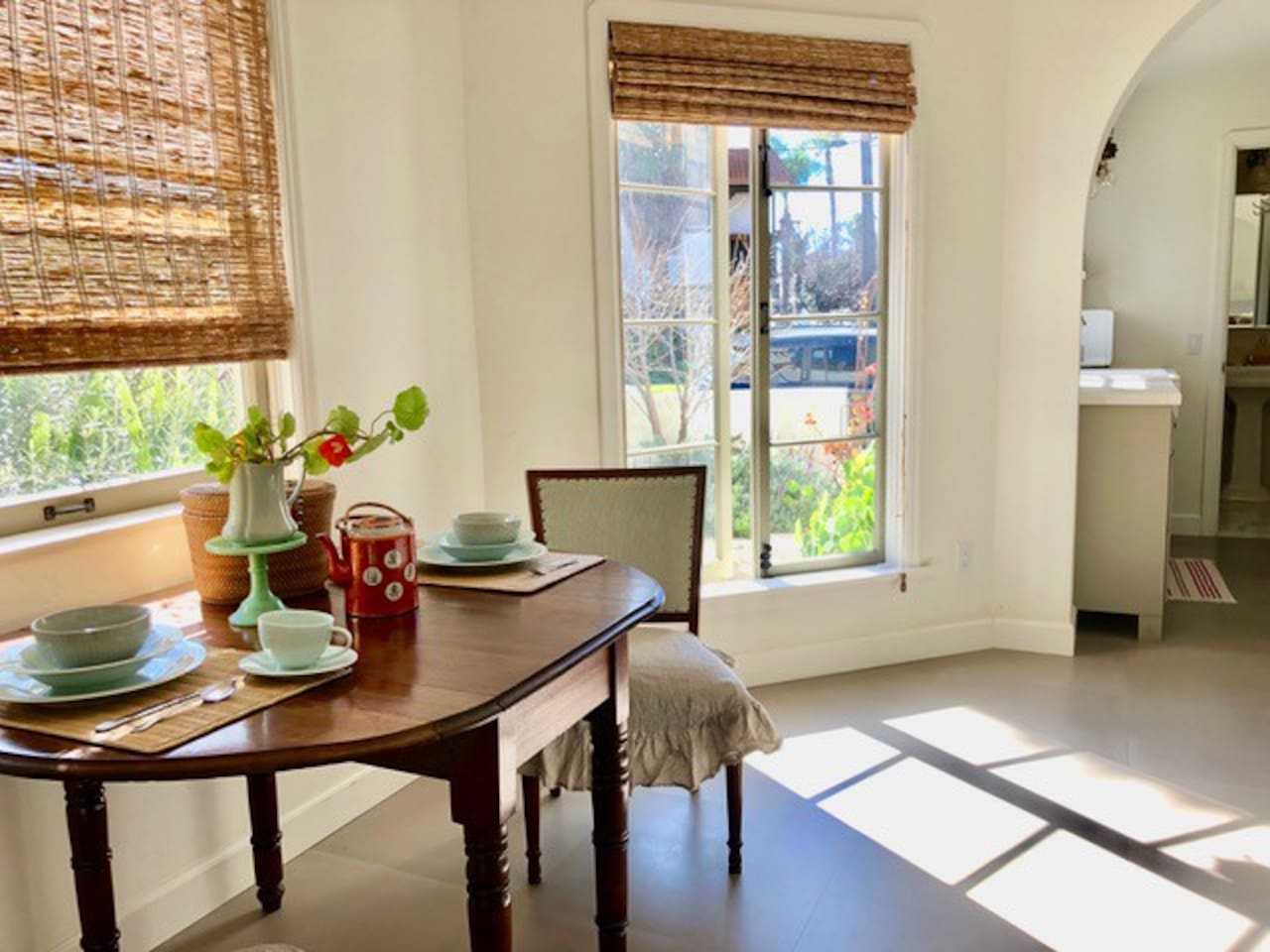 1 BR / 1 BA Bright and breezy Dining space that has a beautiful view  of the rear garden